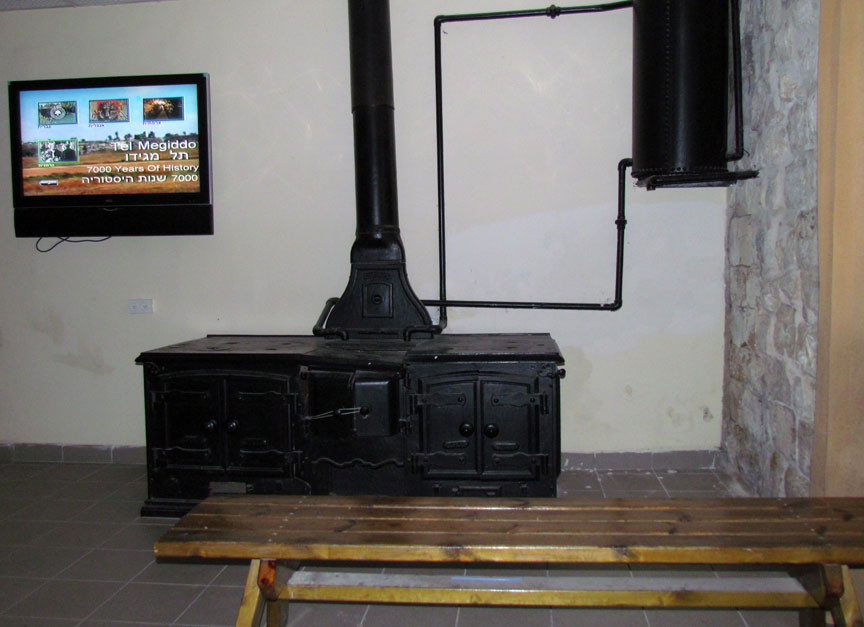 large wood stove/water heater in the room now used as the theater - Tel Megiddo, Israel - Travel Photos By Galen R Frysinger